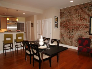 dining room with brick interior wall