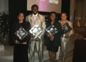 award winners holding plaques